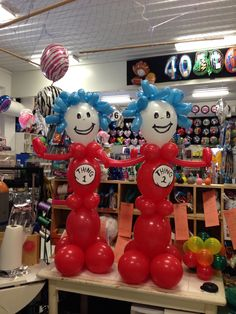Thing one and thing two! Their bodies are red and their hairs are blue!