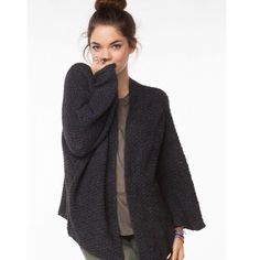Brandy Melville Cardigan Dark grey oversized cardigan. It's called the Voltaire cardigan! Only worn once and in good condition. Let me know if you want more pics of it... Price is negotiable...;) tag had fallen off but it is definitely from brandy Melville!!! NOT SHRUNKEN AT ALL Brandy Melville Sweaters Cardigans