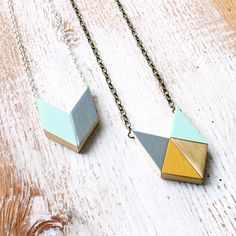 Geometric Wooden Triangles Necklace, Fall-Winter Colors / grey, mint, honey mustard  gold - geometric jewelry - tribal arrow - hip gift. ($36.00, via Etsy)
