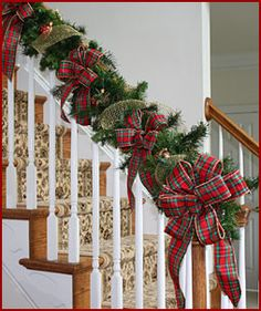christmas stairs i like wrapping with greens instead of draping and the bows look really