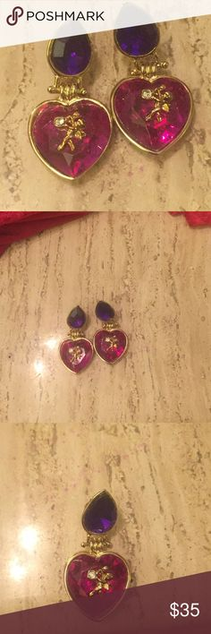 EARRINGS ELEGANT Purple Dangle with Gold Accents. EARRINGS ELEGANT Purple Dangle with Gold Accents.  Trimmed in gold and to love the Heart Shape on the bottom part of these earrings.  NEVER WORN These are a Statement pair of earrings that I doubt you will every see these again❌❌❌❌❌❌❌💥💥💥💥💥💥 Jewelry Earrings