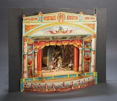 "18"" x 18"" x 15"" German toy theater with brilliant lithographed architecture, stage, dimensional arrangement of scenes, curtains, orchestra, and theater-goers. Circa 1920."