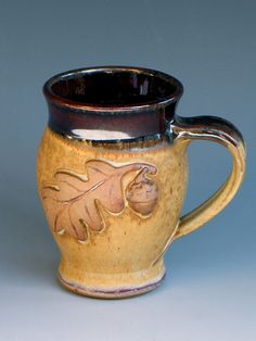 Stoneware mug with acorn and oak leaf