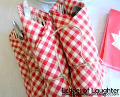 silverware wrapped in gingham napkins - perfect for a picnic