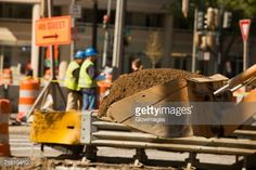 Stock Photo : Close-up of the scoop of an earth mover carrying soil