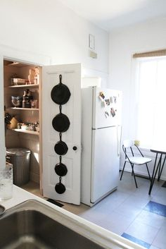Pot storage on the back of a pantry door   Apartment Therapy