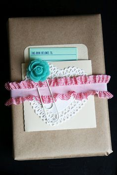 Nice gift combo: wrap a new book with kraft paper...  place library cards into pocket...  add a paper doily,   ribbon and a cabochon bookmark to the front
