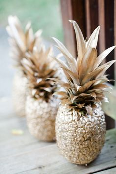 Spray-Painted Pineapples: Spray-painting real pineapples is a cheap and easy DIY, and they are a great addition to the party decor.  Source: KCB Photography