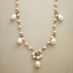 """ROSIE'S PEARL NECKLACE--Cultured freshwater pearls reflect their links' rosy warmth in Eric Van Peterson's glowing play of iridescence. Handmade in London of 18kt rose gold plate on sterling silver. Lobster clasp. Approx. 18""""L."""
