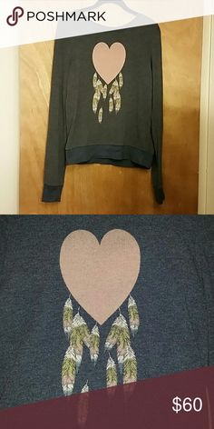 Wildfox Heart Dream Catcher Baggy Beach Jumper This is a beautiful, vintage piece that cannot be captured on photos Wildfox  Manufactured Pilling and added signs of age in graphic and piling,  but still in great condition  Due to the age of this piece,  the BBJ blend are of a thinner nature,  and this is not a sign of wear/age/use Dusty,  Heathered Cornflower blue color First and third photo courtesy of @thirteensporks and is accurate in color Tagged XS,  would also fit S  Ask Questions…