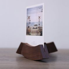 Black walnut cube base won't tip over or fall down. These style memo clips are a fun way to decorate and label your possessions around the house. Hold your photos or memo paper with the holder.