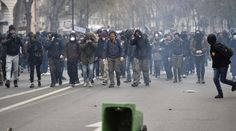 RT crew caught in tear gas in Paris amidst anti-labor reform protests  http://pronewsonline.com  French youths and activists of various youth organisations march past during a demonstration against proposed changes to labour laws in Paris on March 24, 2016 © Eric Feferberg