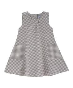 This little dress's handy pockets, allover gingham and roomy silhouette are sure to make it a go-to playtime favorite. Woven from 100 percent GOTS-certified cotton, this earth-friendly treat offers adventure-ready comfort with classic style.