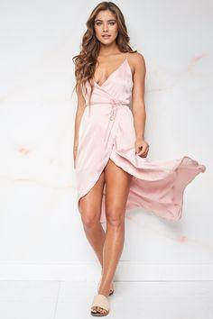 cdcfa6cbe9ed A sexy midi wrap dress featuring a woven satin material