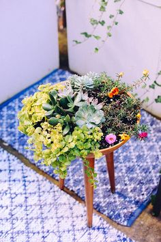 I thought it would be fun today to share one of my favorite DIY projects from The New Bohemians, this tripod planter made from a bowl and vintage legs. It's a great project to do over a weekend now that summer is here. This dude would be perfect for your little patio or balcony. Here's how you...
