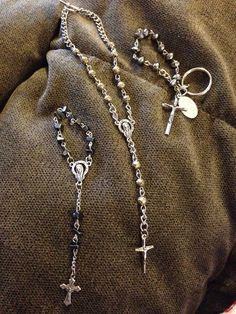 Rosary travel kit.  From left to right: hematite Chaplet, mixed metal car rosary to hang from rear view, and keychain Chaplet.  Can do any color.