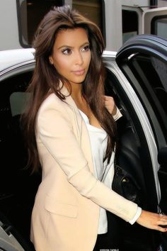 Yes, I'm going through pics of Kimmy K - LOVING this brunette. My next hair color? I think so!