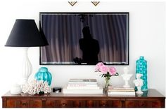 TV above a cabinet that's been styled nicely