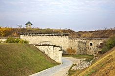Fort Monostor is a late citadel next to the city of Komarom. The fort used to be the biggest ammunition storage of the Soviet Union after World War II, and today can be visited as a museum. Monostor lies also next to the Danube River. Danube River, Colonial Williamsburg, Country Estate, Hungary, All Over The World, 18th Century, Concept Art, Buildings, Sci Fi