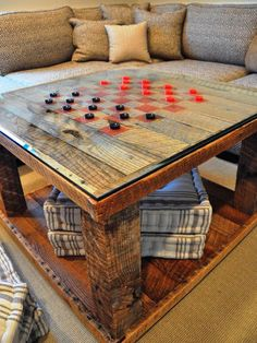 22 Clever Ways to Repurpose Furniture: A salvaged-lumber table is made to multi-task when simple red squares are painted on top to make a checkerboard. From DIYnetwork.com
