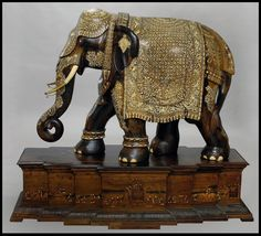 Anglo-Indian; 19th-Century Bone and Ivory-inlaid Teakwood Elephant;    Measures: 35-1/2 inches by 47-1/2 inches.