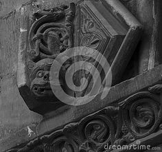 Shot in black and white, detail on the sculpture on the facade of this historic church representing some strange creatures. Set in Lleida, Catalunya, Spain, Europe