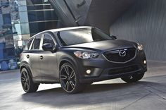 With a quick glimpse, the CX-5 Urban appears to be merely shrouded in a matte finish. First impressions have never been more deceiving. Heavily influenced by design, the vision for the CX-5 Urban was inspired by styles found in fashion and architecture. With a Mazda Design-developed custom paint process, the dark surface of the CX-5 Urban features multi-dimensional shadows with each triangular-like design shaped to reflect each bend and twist of the vehicle's sheet metal. #Mazda #CX5 #SEMA