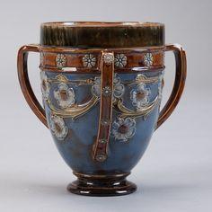 Doulton Lambeth Three Handled Vase  --  Late 19th century Doulton Lambeth tri-handled vase with blue and brown floral glaze.  --   Item:  4097  --  Retail Price:   $895