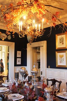 Tallgrass Design: Mary Carol Garrity Fall Home Tour 2012, Part 1. Interesting light fx with fall leaves, sticks and feathers. Love the tablescape.