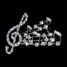 Buy this Music Notes Crystal Pin and add a little bling to your attire! Search our site for unique music jewelry for all musicians.