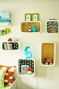 scrapbook paper glued to the back of cube shelves...for displaying toys in kids' rooms