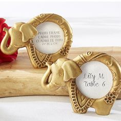 These lucky golden elephant frames are the perfect addition to your indian themed wedding.