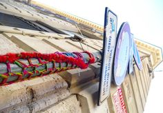 Sometimes it's the little things. I was hot. My feet were blistered and it was standing room only in the tourist mosh pit of the Trevi fountain. But a few hundred yards away ice cold Coke in hand I saw this yarn bombed sign post in an alley and just like that things were looking up. #travel #yarnlove #yarnbomb #rome