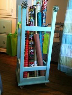 Barstool turned upside down = wrapping paper organizer. Now this is an idea for me! Wrapping Paper Organization, Craft Organization, Craft Storage, Storage Center, Diy Ideas, Craft Ideas, School Posters, Craft Rooms, Organizing Tips