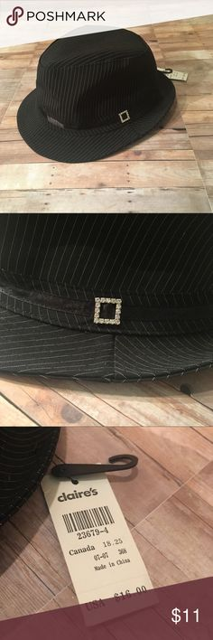 New. Fedora. New with tags. Black fedora hat with with pinstripes. From Claire's. One size fits all. Has a cute faux diamond attachment on the side. Perfect condition, glare in the picture is from the shine from the ribbon attached around the base. Claire's Accessories Hats