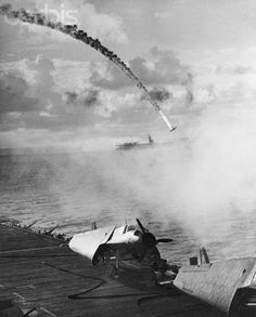 Japanese Fighter Shot Down - BE024637 - Rights Managed - Stock Photo - Corbis. A Japanese fighter plane on a kamikaze mission is shot down by anit-aircraft guns on an aircraft carrier. | Location: Near Saipan.