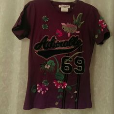 """Christian Dior """"Adiorable"""" top Beautifully Embroidered and embellished with Coy fish and flowers and the #69 front and back. It feels like a fitted shirt with all of the heavy detail...not so stretchy. Gorgeous colors.  Rare find. Christian Dior Tops Tees - Short Sleeve"""