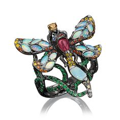 Wendy Yue Dragonfly Ring. Wendy Yue infuses nature-inspired elements into each of her stunning designs This ring uses a unique combination of opals, rubies, tsavorites and diamonds set in blackened 18-karat gold to capture the spirit of the dragonfly.  Opal 0.90cts; Ruby 0.50cts; Tsavorite 1.42cts; Diamond 0.49cts