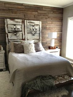 My bedroom inspired by pinterest!!! Not completely finished... rustic chic wall made from pallets headboard old doors crackled and distressed