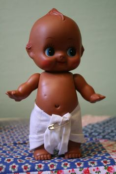 """Vintage Rubber Brown Kewpie Doll...Adorable classic, pose-able Kewpie with a removable cloth diaper. """"Made in Japan"""" marked on back. Stands about 8"""" tall."""
