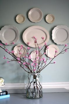 Beautiful tissue paper flowers plus I love the plates on the wall