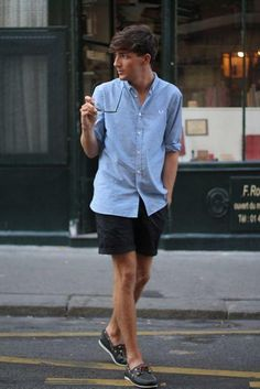 Summer in the city. Simple shorts and shirt teamed with classic deck shoes. Menswear to inspire. A real timeless look.