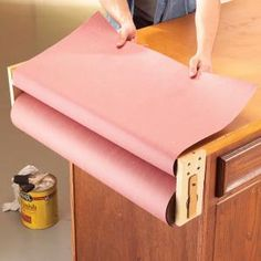 Protect your workbench with rosin paper. Install this simple paper holder at one end of the bench and roll it out when you need it.