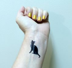 Temporary Tattoos are so fun and such an easy way to add a unique element to your look. Using different tattoos is fun and simple! ►DESIGN: Cat ►SIZE: 1 inch height x 1/2 inch width ►QUANTITY: One ►APPLICATION: Apply tattoo to clean, dry skin. 1) Peel back film cover. 2) Place tattoo face down on your body. 3) Firmly press a damp cloth or sponge over the back of the tattoo. 4) Wait 60 seconds before s-l-o-w-l-y peeling the backing of the paper 5) Let dry & Thats it! Enjoy your t...