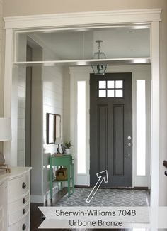 entryway with dark gray door. urbane bronze by Sherwin williams