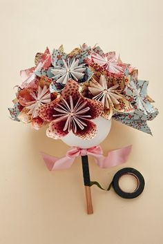 DIY origami bouquet.   See website for instructions:  http://www.bridesmagazine.co.uk/planning/receptions/diy-details/2013/04/origami-flower-bouquet
