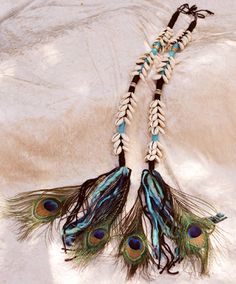 Cowrie shell peacock hair tassels- I want to make something similar..