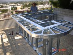 curved custom outdoor kitchen c-01. constructed with a galvanized