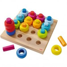 Rainbow Whirls Pegging Game. Teaches colors, sorting and pattern skills. Made in Germany.