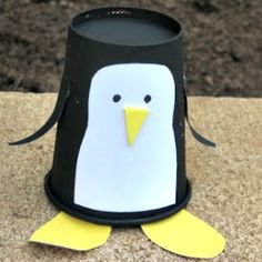 Make a penguin craft out of a paper cup! - A unique outdoor movie night theming idea from Southern Outdoor Cinema. easy craft for the children!